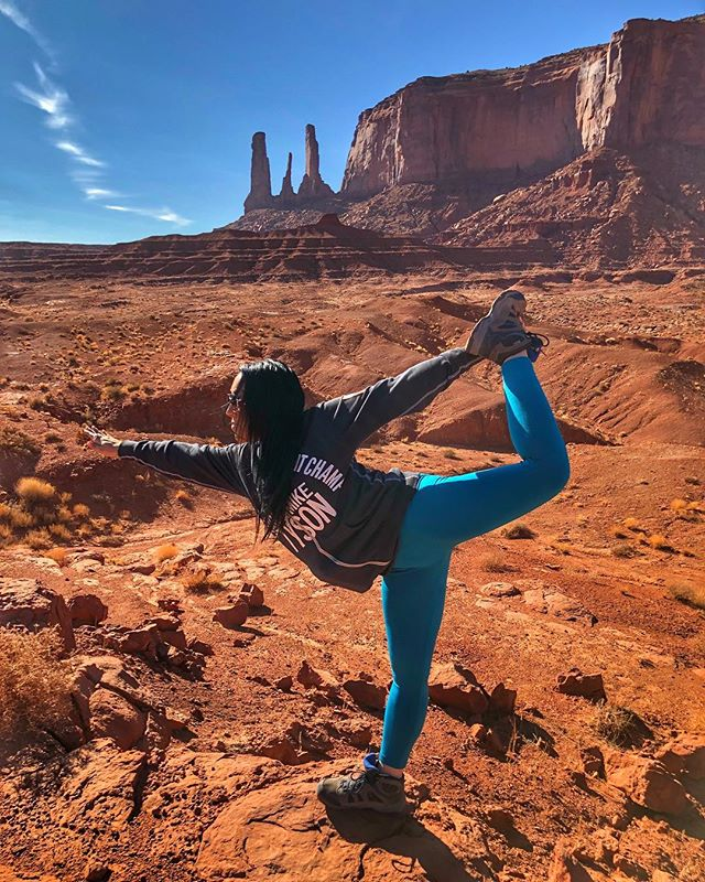 Dancers pose in Monument Valley……